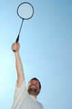 Happy man a racket Stock Photography