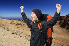 Happy man with raised arms amid the volcanic landscape of Tenerife. Teide Volcano. Royalty Free Stock Image