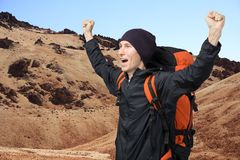 Happy man with raised arms amid the volcanic landscape of Tenerife. Teide Volcano. Stock Images