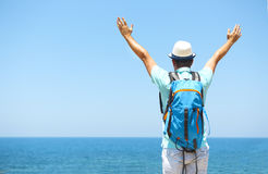 Happy man raised arms on beach Travel and vacarion concept Royalty Free Stock Image