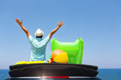 Happy man raised arms on beach Travel and vacation concept Stock Image