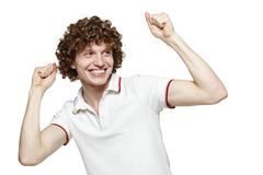 Happy man with raised hands Stock Photos