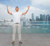 Happy man with raised hands Royalty Free Stock Photo