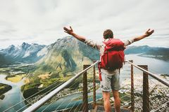 Happy man raised hands enjoying aerial mountains. Landscape Travel Lifestyle adventure vacations success emotions in Norway standing alone on Rampestreken Royalty Free Stock Photos