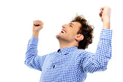 Happy man with raised hands up. On a white background Stock Photos