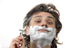 Happy man with razor Stock Photography