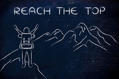 Happy man reaching the top of a mountain, with text Reach the to Stock Images