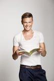 Happy man reading book royalty free stock photo