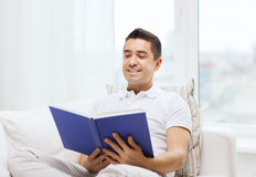 Happy man reading book at home Royalty Free Stock Photography