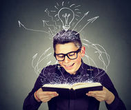 Happy man reading a book. Happy young man reading a book Royalty Free Stock Photo