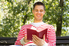 Happy man reading a book Stock Photography
