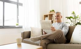 Happy man reading newspaper at home Royalty Free Stock Photography