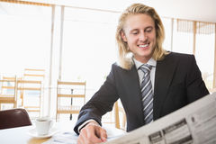 Happy man reading newspaper Stock Image