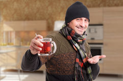 Happy man recommend a cup of hot tea Royalty Free Stock Photo