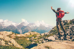 Happy Man with red backpack jumping hands raised Royalty Free Stock Image