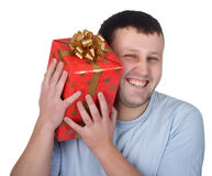 Happy man with a red gift Royalty Free Stock Photography