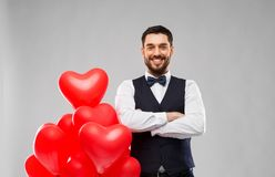 Happy man with red heart shaped balloons royalty free stock photos