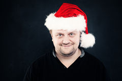 Happy Man in Red Santa Hat. Christmas Stock Image