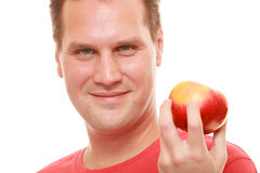 Happy man in red shirt holding apple. Diet health care healthy nutrition. Stock Photo