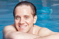 Happy man relaxed in the edge of the pool Stock Image