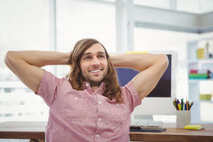 Happy man relaxing at computer desk Royalty Free Stock Photography