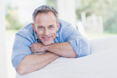 Happy man relaxing on the couch Stock Images
