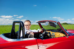Happy man relaxing in his cabriolet Royalty Free Stock Images