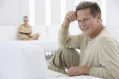 Happy Man Relaxing In Living Room Stock Photos