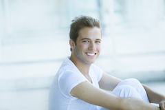 Happy man relaxing. Happy young man relaxing outdoors Stock Photo