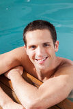 Happy man rest in the edge of the pool Stock Image