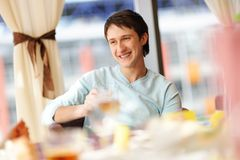 Happy man in a restaurant Stock Photo