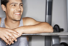 Happy Man Resting On Barbell After Workout Royalty Free Stock Image