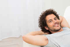 Happy Man Resting On Sofa Stock Photography