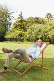 Happy man resting in sun lounger Stock Photography