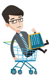 Happy man riding by shopping trolley. Stock Image