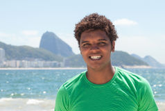 Happy man from Rio de Janeiro at Copacabana beach Stock Photos