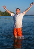 Happy man running in water Royalty Free Stock Image