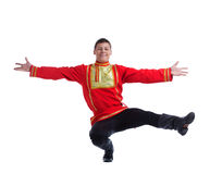 Happy man in russian costume performing dance Stock Images