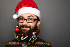 Happy man in santa claus hat over grey background Royalty Free Stock Image