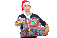Happy man in Santa hat offer gift Stock Images