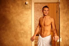 Happy man after sauna. Happy man leaving steam after healthy sauna, athletic guy in wellness Stock Photos