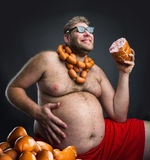 Happy man with sausages Royalty Free Stock Photos