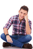 Happy man seated on studio Stock Image