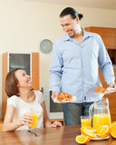 Happy man serves breakfast her beloved wife Stock Images