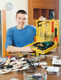 Happy man with set of working tools Stock Images