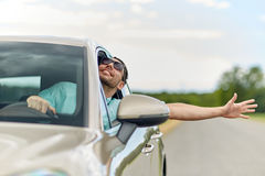 Happy man in shades driving car and waving hand royalty free stock image