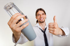 Happy man with shaker making cocktail drink Royalty Free Stock Images