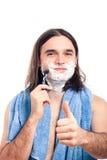 Happy man shaving Royalty Free Stock Image