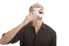Happy man shaving Stock Photography