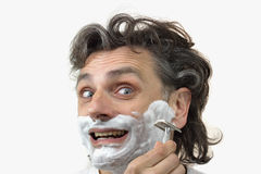 Happy man with shaving cream Royalty Free Stock Image